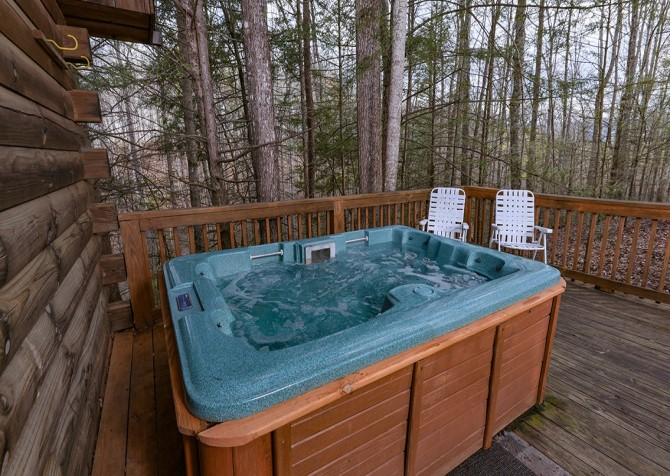 Gatlinburg cabin rentals precious moments for Cabin in gatlinburg with hot tub