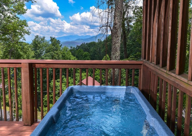 Gatlinburg cabin rentals a romantic hideaway for Cabin in gatlinburg with hot tub