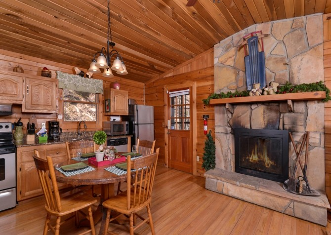 Pigeon Forge Cabin- Irresistible – Dining Area Fireplace