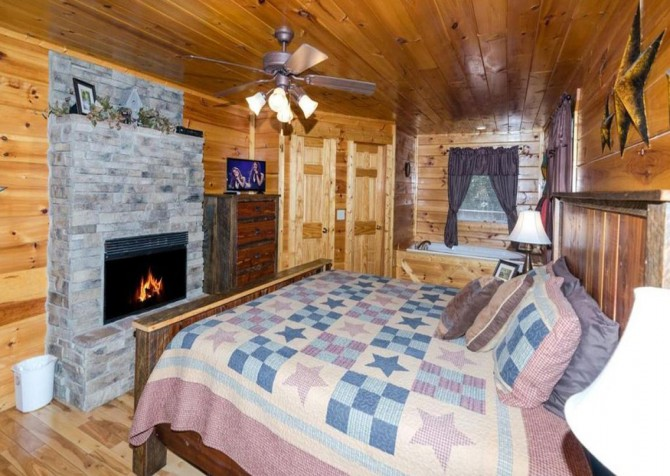 Pigeon Forge - Bear Hiney Hideaway - Bedroom One & Fireplace